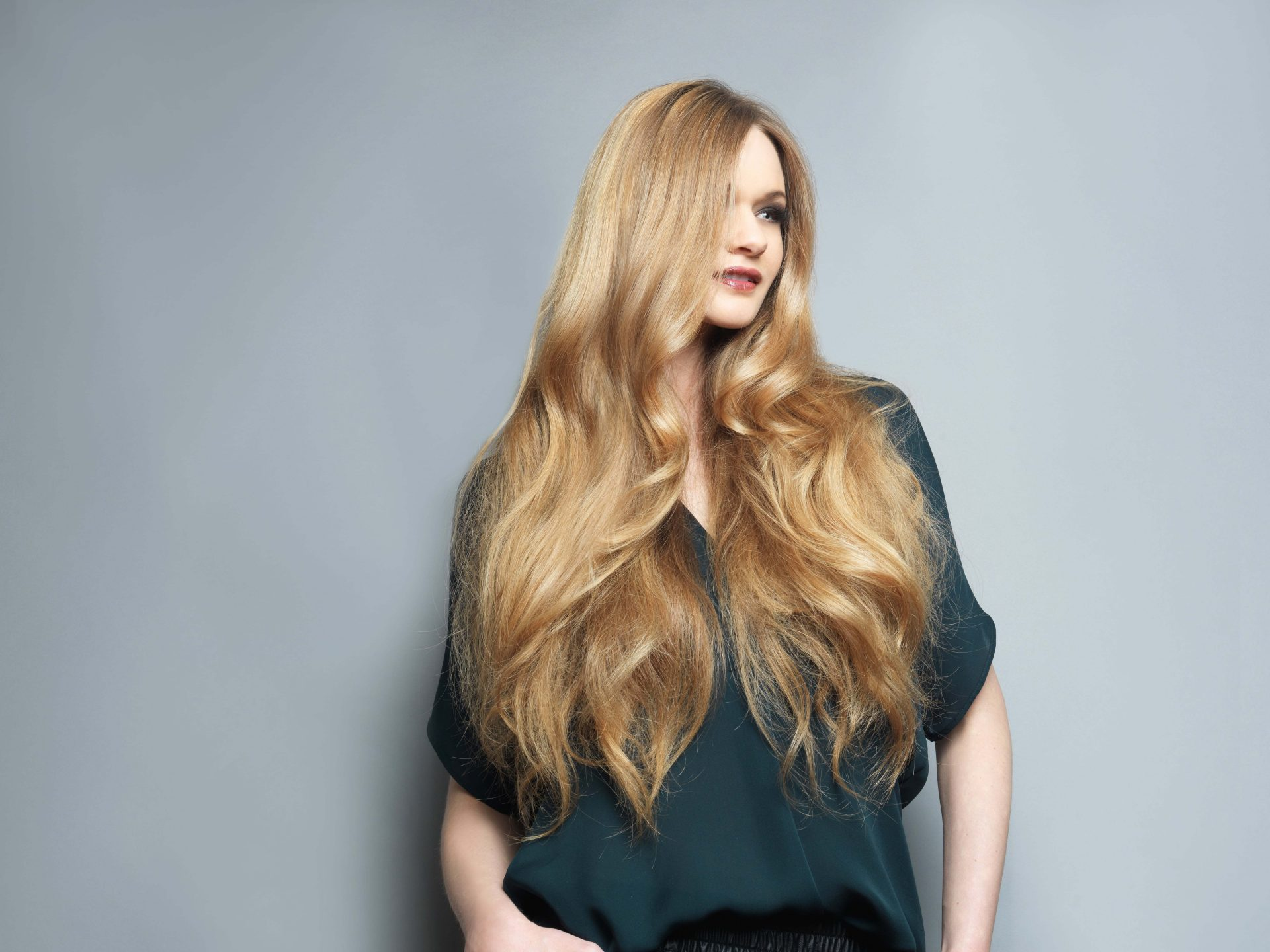 A model showing long wavey hairstyle by Mitchell's salon